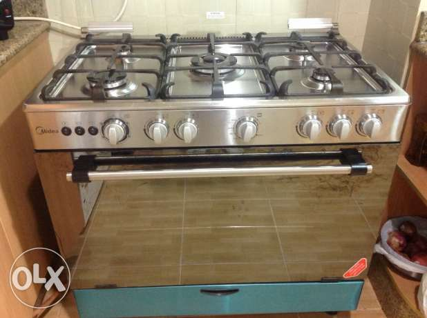 Gas stove Midea and exhaust brand for sale