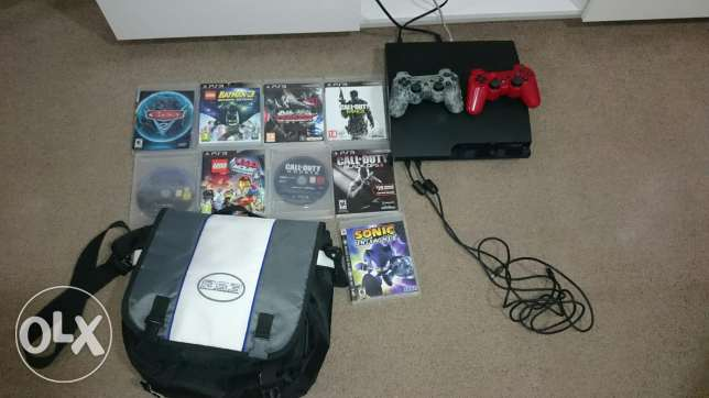 PS3 with 2 controllers and 9 CDs