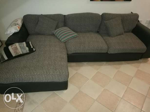 Great big couch with some damage