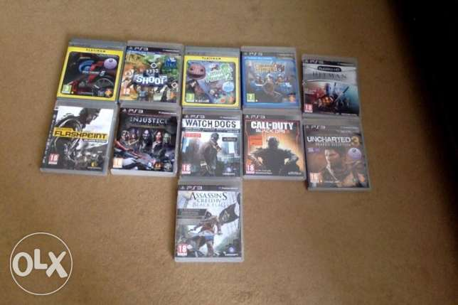 PS3 with 1 duel shock 3 controller and 11 games