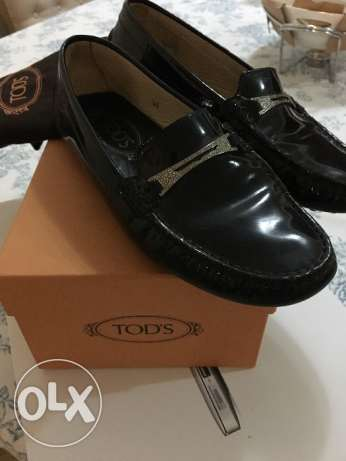 Black patent women's TODS loafers