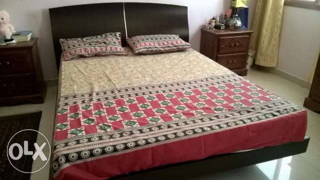 queen size wooden bed with mattress from home center in good condition