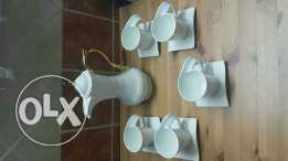 Teapot with 5 cups and saucers for sale