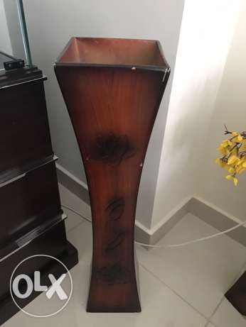 Wooden vases with flowers