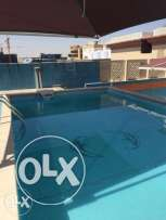 Luxury Fully Furnished 1-Bedroom Flat in Umm Ghwailina-Pool