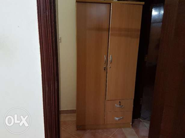 Wooden wardrobes and additional items.