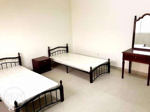 for bachelors..semi furnished 3 bedroom apartment at al ghanim