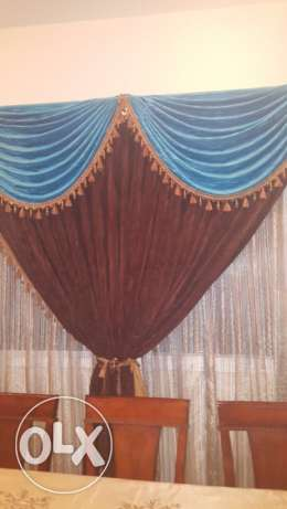 Two full curtain sets with the stands in excellent condition
