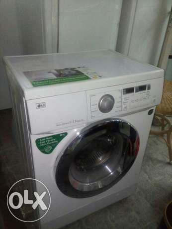 Washing machine LG exelent working front loader home delivery