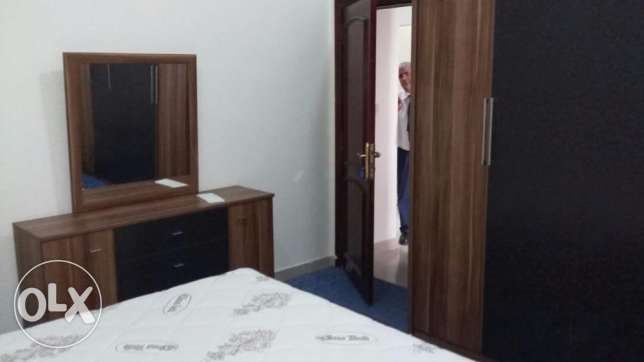 Fully-Furnished 2-Bedroom Apartment in Al Sadd السد -  3