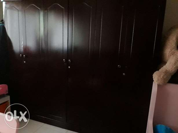 A dining table and a large wardrobe for sell
