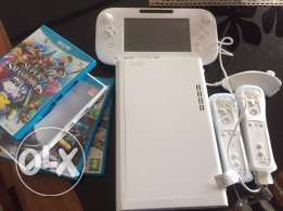 Wii U (Barely used) Two controllers, four games, 8Gb, Censor, Game pad
