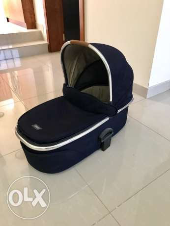 blue carry cot