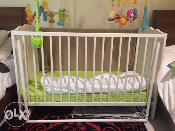 Baby wooden crib from Ikea + matress + sheets + bedtime toys
