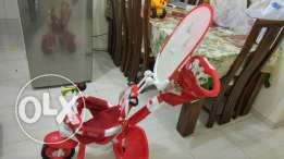 FisherPrice branded tricycle with Parent assisted handle