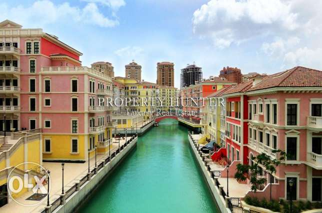 2 BR with canal views in the colourful Qanat Quartier