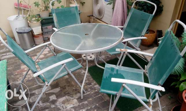 Outdoor table with four chairs