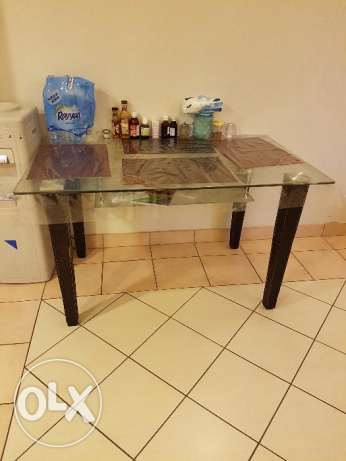Glass top dinning table from home center