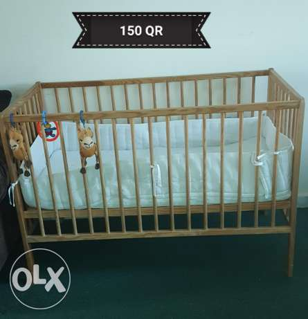 Baby cot with mattress and bumper