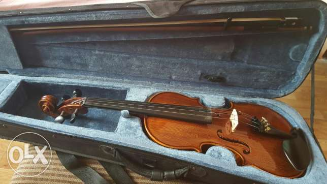 A germany violin with a bow and a box