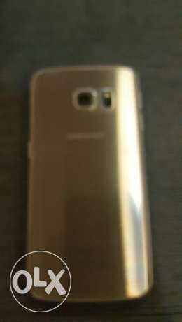 Samsung galaxy s6 edge for sale with 3 covers but a crack on the edge