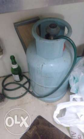 Gas cylinder + 3 burner stove + regulator+ pipe