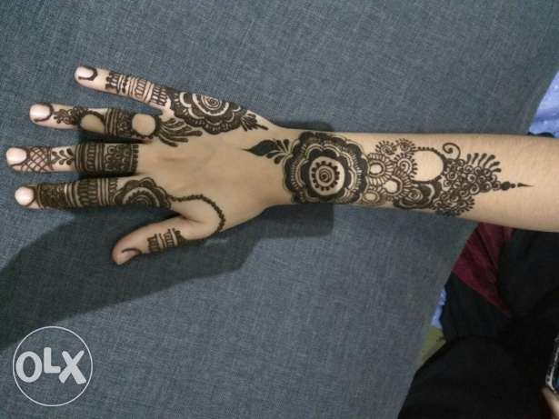 Instinct Henna Designs on hand