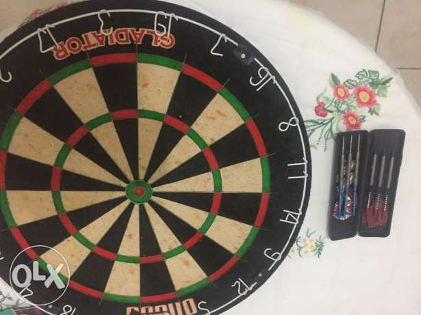 Dart board and 2 dart sets