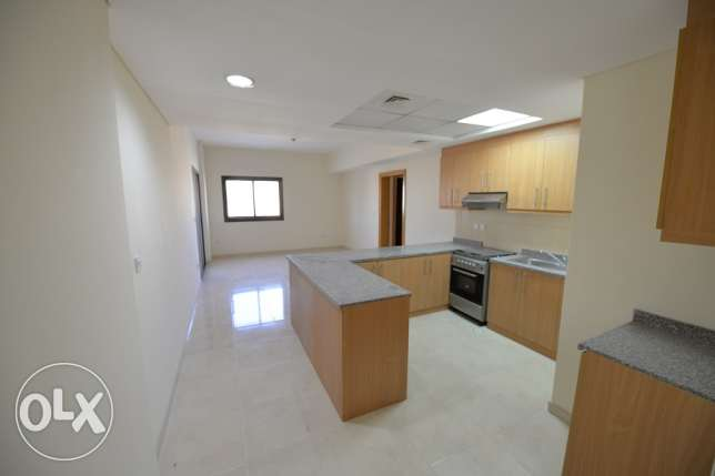 Brand new unfurnished 1BD apartment with open kitchen in lusail city