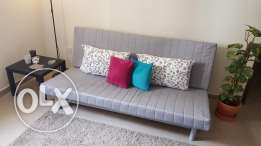 semi-new three-seat sofa-bed for sale