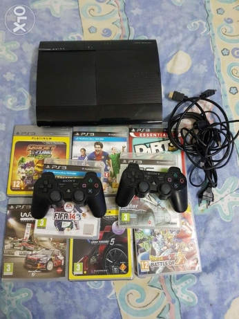PS3 super slim.,500GB with 8 games, 2 wireless joysticks.
