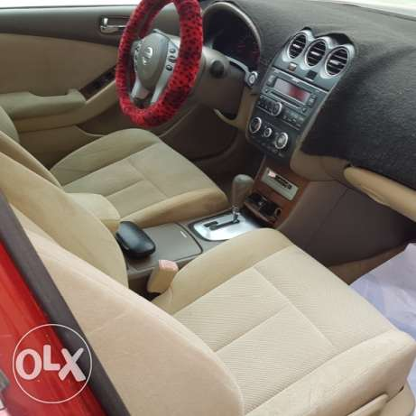 Nissan altima 2009 full option. red Color. very clean . new istimara