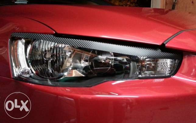 Carbon Eyelids Headlight for Mitsubishi Lancer
