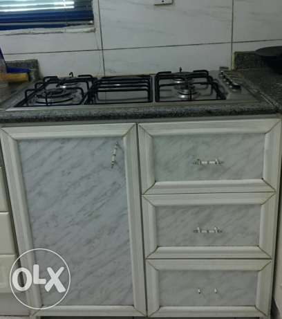 Gas stove with cupboard