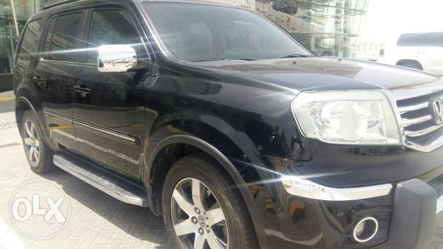 Honda pilot full option with navigation,sunroof and leather seats
