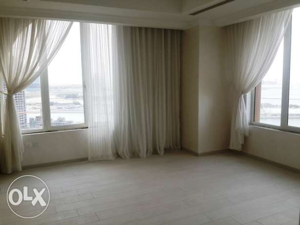 All white apartment of 2 bedrooms semi furnished at Porto Arabia