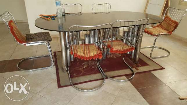 Glass and stainless Dining table