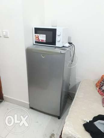 Slightly used 300litre Sanyo fridge and LG Microwave.