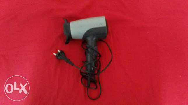 A very powerful Hair dryer with 3 different hair brushes