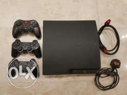 PS3 with 3 controllers ( 2 wireless) and 8 games