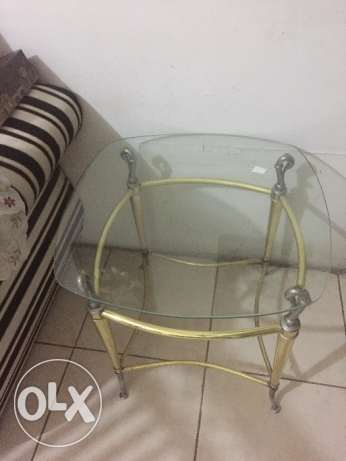 Glass tables for sale with gold and silver edges