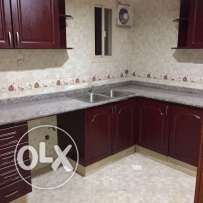 Semi Furnished 2-Bedrooms Apartment in Villa in AL Gharaffa,Water,Elec
