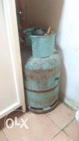 Gas cylinder with gas stove