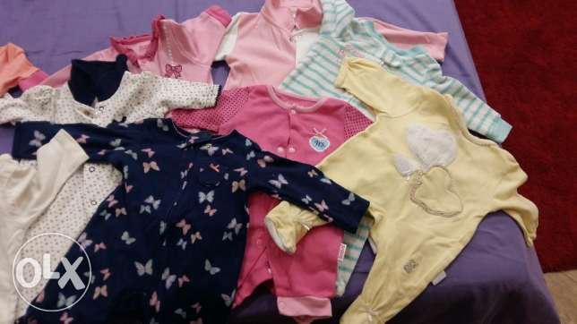 Like new 60 pieces new born clothes+baby sleeping bag gift only 250qar