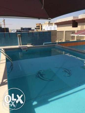 Luxury FF 1-Bedroom Flat with Pool/Gym in Umm Ghwailina